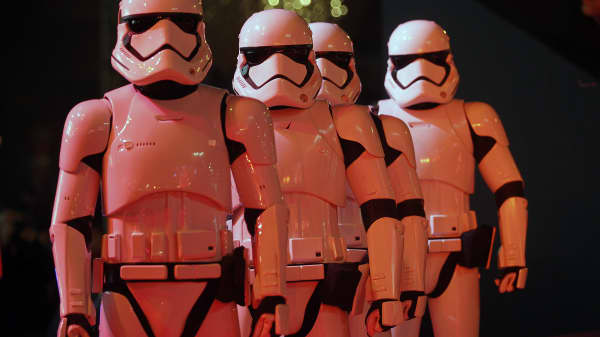 Actors dressed as Storm Trooper characters from 'Star Wars' movie 'Star Wars Episode VII : The Force Awakens' attend the launch of Christmas lights at Galeries Lafayette department store on November 4, 2015 in Paris, France.